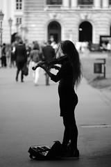 Nice melody... (PIXXELGAMES - Robert Krenker) Tags: newspaper news cafe kaffee wien snapshot unknown candid portrait portret schwarzweiss blackandwhite blacknwhite bnw fujifilm fujinon filmsimulation lifestyle street streetstyle urban streetphotographer streetphotography biancoenero violine geige musiker musikerin geigerin string longhairs shadow silhouettegirl blond vienna vivaldi summer spring ritrato student