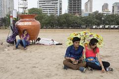 _MG_5040 (travelstreetmodel) Tags: mumbaitravelindiastreet photographycanon 6d chowpattybeach sand umbrella glum chat chatting beach
