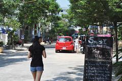 Cafe row (Roving I) Tags: street trees cafes girls signs blackboards smoky danang vietnam