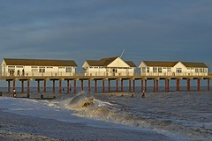 Southwold Pier, Suffolk (DaveJC90) Tags: suffolk southwold pier souhtwoldpier building old classic wood metal lighthouse sea water northsea long exposure autumn winter sunrise sunset sun sunny sunlight light bright night sky blue cloud cloudy dark shadow beach bay hut huts reflection wave waves move movement colour colours crop croped nikon d5100 digital slr camera wide angle zoom lens 1020mm 1855mm detail sharp sharpness view landscape