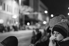 Watching the lights (LostOne1000) Tags: fireandice cedarrapids blackwhite iowa child christmas parade downtown unitedstates us holidaydelightparade