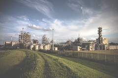 industrious (I AM JAMIE KING) Tags: sky industry metal clouds river shiny pipes hull chemicals petrochemicals