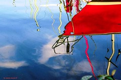 red reflections (mare_maris very slow) Tags: blue light red sea abstract reflection texture nature water colors beautiful clouds marina reflections greek harbor daylight colorful mediterranean mare ship image harbour yacht outdoor shapes explore greece coastal fantasia reflejo stunning ropes oilpaintings reflexions waterscape saronicgulf onthesurface pireaus sailingboat  stunningbeauty cloued  calmwaters  lifeinwater mediterraneanlight likeoilpaintings november2015  nikond5100 maremaris rotatedreality withoutbrushesandpaints ripplesandcolors
