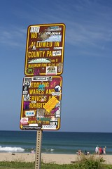 Do Not something (daniel_james) Tags: ocean usa beach sign naughty hawaii stickers kauai hanalei defaced 2015