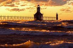 Translucent Waters (Tom Gill.) Tags: sunset lake storm pier waves wind michigan stjoseph lakemichigan greatlakes catwalk llighthouse lighthousetrek