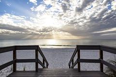 the meaning of florida (Satirenoir) Tags: light sunset beach clouds stpetersburg sand treasureisland florida empty sunsetbeach godlight