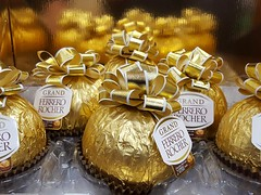 290/366 All That Glitters Isn't Always Gold (Helen Orozco) Tags: 2016366 ferrerorocher chocolate indulgence swizz galaxy gold sweets candy golden