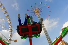 Four fairground attractions (Johan Konz) Tags: fairground attractions damsquare amsterdam netherlands outdoor blue sky white clouds people stratosphere vertigoride wheel gforce