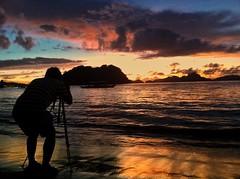 Photographer in action. Chasing the last light of the at Las Cabanas Beach, El Nido, Palawan. #iphonephotography (hijo_de_ponggol) Tags: photographer action chasing last light las cabanas beach el nido palawan iphonephotography