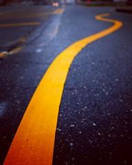 Stay alert! (Jamie McCaffrey) Tags: humor funny crooked wobbly roadmarkings arundelmills maryland fuji x100s yellowline