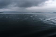 Darker days, coalescence (zh3nya) Tags: water dark foreboding looming blue monochrome ferry washington wa washingtonstate waves sea ocean sound straight sanjuanislands atmospheric salishsea d750 sigma35mmf14 pnw pacificnorthwest
