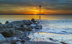 Solent Sunrise (nicklucas2) Tags: seascape beach isleofwight needles sea groyne sunrise solent seaweed sun wave