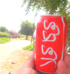 Globalization (David Darricau) Tags: coke cocacola can afrique africa case sénégal muslim arabic 2016 drink hand village tree red green mondialisation