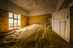 Room With A View (PhotoGizmo) Tags: kolmanskop namibia abandoned mining town africa sand desert indoors old rundown dune floor window day inside door doorway paint peeling ceiling horizon dry daylight sunny shadow shadows light white brown trim tracks drift drifting quiet place icon iconic stuck broken broke wall corner building buildings room view