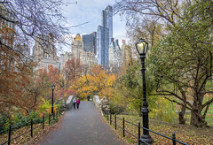 Central Park in Autumn (JMS2) Tags: centralpark autumn fall foliage park people gapstowbridge cityscape architecture skycrapers newyorkcity