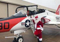 Santa Claus and an elf get out of a T-45C Goshawk for a Christmas party. (Official U.S. Navy Imagery) Tags: navy naval aviation people christmas santa aircraft meridian miss usa
