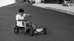 kart champion (flytland) Tags: road street blackandwhite bw france monochrome child stranger nb unknown fujifilm rue ardeche photoderue inconnu xm1