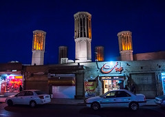 wind towers used as a natural cooling system in iranian traditional architecture, Yazd Province, Yazd, Iran (Eric Lafforgue) Tags: city travel people urban building tower tourism horizontal architecture night outdoors persian day view desert iran traditional text middleeast culture persia architectural bluehour script tradition catcher orient cultural windcatcher yazd windtower badgir persiangulfstates smallgroupofpeople coolingsystem  buildingexterior  16992 colourimage  iro arabicalphabet  yazdprovince builtstructure westernasia