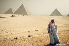 Camel driver in front of pyramids (hapePHOTOGRAPHIX) Tags: gizagovernorate ägypten eg 818egy africa afrika cheopspyramide chephrenpyramide egipto egypt geschlecht gizanecropolis granpirámidedeguiza greatpyramidofgiza mann mykerinospyramide nikond2x pirámidedejafra pirámidedejufu pirámidedekefren pirámidedekeops pirámidedemenkaura pirámidedemicerino pirámidesdegiza pyramidofcheops pyramidofkhafre pyramidofkhufu pyramidofmenkaure pyramidenvongizeh pyramidsatgiza gender hapephotographix male males man men áfrica dsplyys