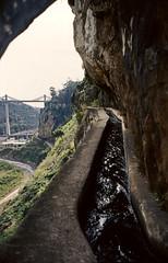 Madeira - Levada (irrigation) (Stefan Ulrich Fischer) Tags: portugal water architecture 35mm landscape island europe slide historic scanned genius analogue levada irrigation kodakektachrome wetfeet minoltaxd7