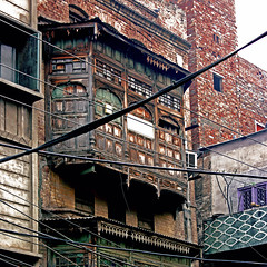 kashmiri bay window, old city, lahore (Maryam Arif) Tags: kashmir baywindow lahore oldcity pakistan perspective composition perception photography maryamarif light contrast shadow streetlife street structure space artistic levels observation