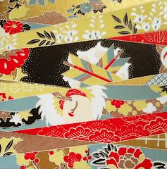 Kyoto yuzen washi 4 (tengds) Tags: handmadepaper japanesepaper yuzenwashi kyotoyuzen washi chiyogami red white gray brown tan black lattice flowers arrows tengds