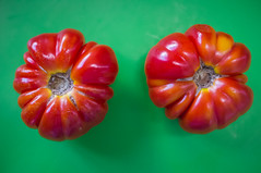 Two Ripe Tomatoes (Maria Sciandra) Tags: red stilllife green mexico indoor vegetable minimalism foodphotography heirloomtomato kitchenart colorbackground fujifilmx100 mariasciandraphotography