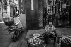 Xiamen-044.jpg (brenroy) Tags: china street blackandwhite architecture streetphotography xiamen scooters motorbikes streetstall shopkeeper qingjingmosque quanzhoushi fujiansheng