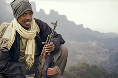 The Mountain Guard (departing(YYZ)) Tags: africa travel portrait people cliff mountain cold smile outside nationalpark gun tour tourist weapon daytime guide ethiopia ak47 hardy eastafrica simienmountains sonnartfe55mmf18zalens