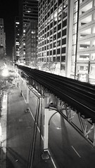 Wells St. (b&w) (williamw60640) Tags: blackandwhite chicago parkinggarage traintracks officebuilding nightscene theloop urbanscape elevatedtrain chicagotransitauthority cityscenes wellsst