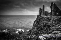 Dunluce Castle & Cliffs B&W (Mark R Farrington) Tags: uk sea blackandwhite bw castle monochrome rain architecture contrast canon photography eos coast ruins europe britain cliffs 7d northernireland ulster countyantrim dunluce dunlucecastle desc2012