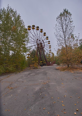 Pripyat Amusement Park (Chernobyl Exclusion Zone)_6 (Landie_Man) Tags: none pripyat chernobyl ionising radiation radioactive fair fairground amuse amusements amusement park may day parade soviet union ussr cccp disused abandoned forgotten left sad never opened ran communism communist fun ferris wheel bumper cars dodgems swing ride swings nature reclaim redstar red star cliche clche