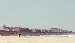 (Alexander Graeff) Tags: marroco leica mini 2 analoug analog film 35mm noise beach strand marocco sky sand dust people outdoor himmel fishing boat cove cave rock essouria