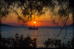 Because every sunset is unique (Vagelis Pikoulas) Tags: sun sunset september autumn 2016 boat ship porto greece europe sea seascape landscape view trees tamron 70200mm