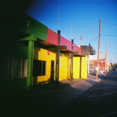 Diana bright buildings (jfpj) Tags: redwoodcity california bright color building yellow red green film fuji fuji400film lowresolution plasticcamera plasticlens plastic toycamera dianamini