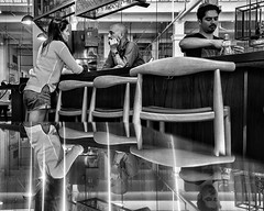 Two Sides To Every Story (Steve Mitchell Gallery) Tags: people talk communicate story twosidestoeverystory reflection reflections bar bartender bartenders street
