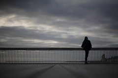 Alone (4foot2) Tags: hastings hastingspier low lowdown candid people peoplewatching interestingpeople stretch stretching runner sea seawater seaside seafront pier helios helios44m 58mm russianlens f2 eos5d canon5d man silhouette clouds dark darkclouds 2016 fourfoottwo 4foot2 4foot2photostream 4foot2flickr
