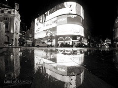 Taxi Chain in the rain - Piccadilly Circus - London (Luke Agbaimoni (last rounds)) Tags: taxis taxi cab piccadillycircus piccadilly reflection mirror reflect blackandwhite night london wet rain rainy