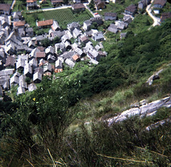 img176 (foundin_a_attic) Tags: switzerland july 1975 stone roof roofs houses view hill green fields trees chalet swiss mountain