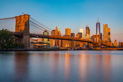 Morning Glow (Amar Raavi) Tags: brooklyn brooklynbridge janescarousel empirefultonferry brooklynbridgepark buildings downtownmanhattan eastriver longexposure lowermanhattan manhattan nyc newyork newyorkcity oneworldtradecenter skyscrapers sunrise water waterfront dumbo skyline unitedstates freedomtower financialdistrict dawn cityscape architecture city downtown gold sunlight bright iconic historic