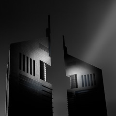 Emirates Towers (leguico) Tags: city light urban blackandwhite bw building architecture blackwhite dubai cityscape shadows skyscrapers fineart towers uae shapes architectural emirates shape wwwtravelphotoandmorecom