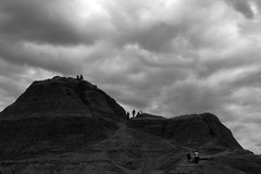 Badlands II (Sean Anderson Media) Tags: blackandwhite cloud nature monochrome clouds southdakota landscape outdoor badlands stark figures rockformation holgalens