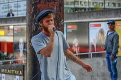 (Dale Michelsohn) Tags: road street city hat smart fashion stone tattoo town nikon artist tour dale theatre sweden stockholm song walk lion dancer sandwich tourist beggar suit eat cap advert singer shops microphone performer tat busk watcher sergel dalem kennybrown anslagstavla d7000 dalemichelsohn