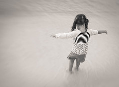 Free (adriedeets) Tags: beach water girl dress arms stripes pigtails embrace