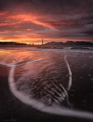 Beyond the Gate (_JonathanMitchellPhotography_) Tags: pictures ocean sf california park bridge light sunset seascape storm color art fall tourism beach nature water field rain clouds photoshop dark landscape flow photography golden bay timelapse gate san francisco artist cityscape photographer pacific photos outdoor sony marin stock fine wave adventure burn goldengatebridge national nd area headlands prints custom filters crissy graduated recreational 2015 burningclouds a7r leefilters