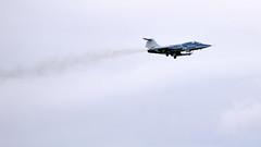 The old ones smoke a lot - Lockheed/Canadair CF-104D Starfighter c1965 landing Toronto Pearson 2006 (edk7) Tags: ontario canada plane airplane aircraft aviation military jet 2006 nikond50 lockheed mississauga twoseater yyz supersonic torontopearsonairport c1965 fightertrainer n104rb sn104632 starfightersinc edk7 canadaircf104dstarfighter exroyalcanadianairforcercafandcanadianarmedforcescaf exroyalnorwegianairforce orendageneralelectricj79oel7ge7axialflowafterburningturbojet10000lbf