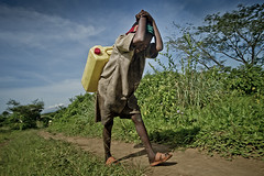 Following Harerimana Sebihogo, a refugee and his family who settled in Rwamwanja site. (( Voice Nature. )) Tags: water children uganda jerrycan centralafricaandthegreatlakes congoleserefugees westernuganda rwamwanja