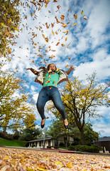 Youthful exuberance. (Flickr_Rick) Tags: autumn woman fall girl leaves outside jump jumping breanne jumpology