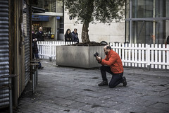 Praying for a good shot (tootdood) Tags: street camera manchester triangle shot good candid praying kneeling popupflash liveview canon70d