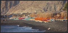 He prefers the ground (ibarenogaray) Tags: beach sunbeds orange